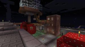 Shroom Mansion, Jon's multi-level extravaganza, in front of Gaines' austere brick cube.